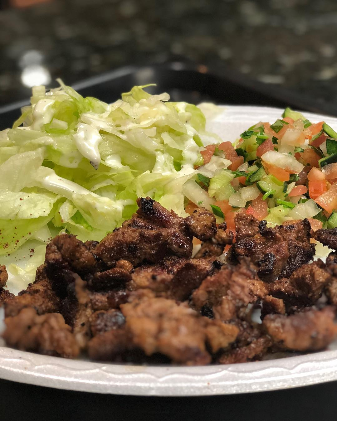 Since I'm out running around and working all day, stopping at a Greek place was a good way to stay on diet… I got extra salad instead of rice and won't be indulging in the tomatoes… the lamb is amazing and the tzatziki sauce is so yummy with it