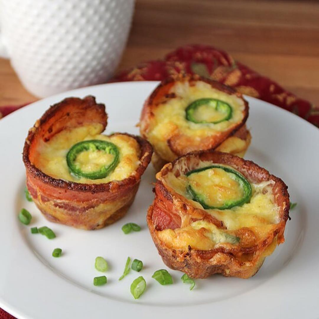 I don't even like jalapeños and this looks yummy! —— Repost @ruledme ・・・ If you're a fan of jalapeno poppers, then do yourself a favor and give these a try. They're the right amount of heat, the right amount of cheese to balance it out, and then bacon to really take it up a notch. All nested within a fantastic egg muffin to easily take with you anywhere!⠀ —— INGREDIENTS⠀ 4 ounces cheddar cheese⠀ 3 ounces cream cheese⠀ 4 medium jalapeño peppers, de-seeded and chopped⠀ 12 strips bacon⠀ 8 large eggs⠀ ½ teaspoon garlic powder⠀ ½ teaspoon onion powder⠀ Salt and pepper to taste⠀ —— NUTRITION⠀ This makes a total of 12 Jalapeno Popper Egg Cups. Each Egg Cup comes out to be 157.17 Calories, 12.28g Fats, 1.35g Net Carbs, and 9.75g Protein.⠀ —- Full recipe:⠀ ruled.me/jalapeno-popper-egg-cups/