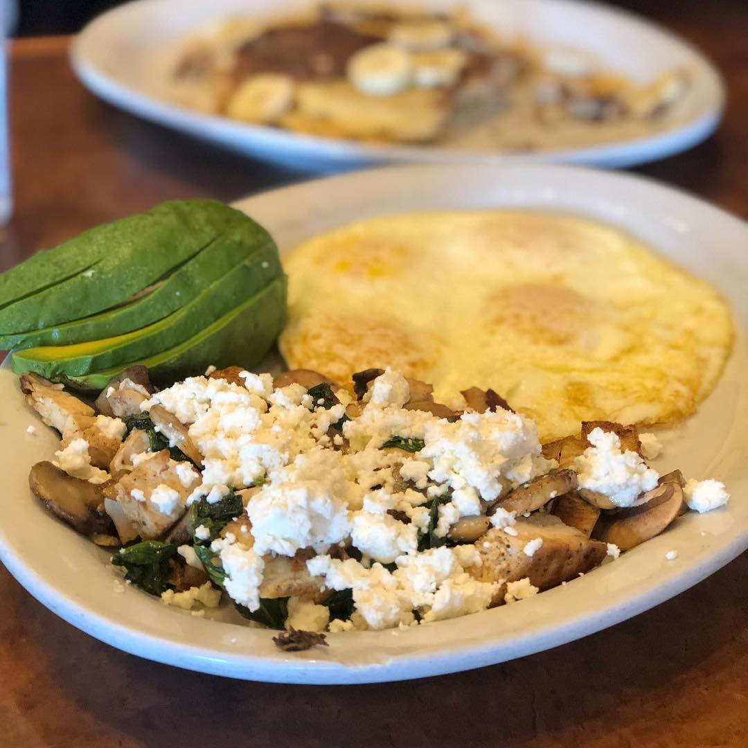 Breakfast this morning @stacksandyolks was delish! I had the griddle platter minus the bread and potatoes… chicken, spinach, mushrooms and feta with 4 eggs over medium… and half of an avocado to boot!! Yum